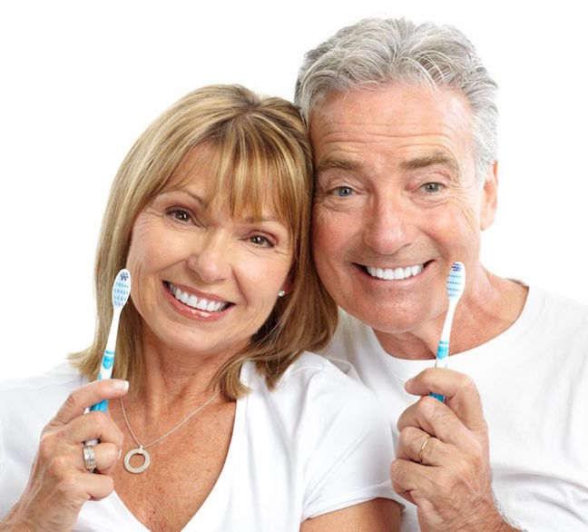 7231944 - happy seniors couple with toothbrushes. healthy teeth. isolated over white background
